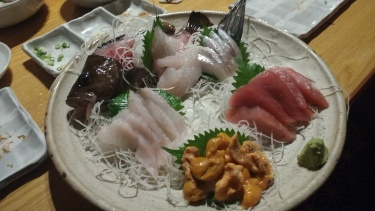 Just one tray of an endless parade of sashimi.
