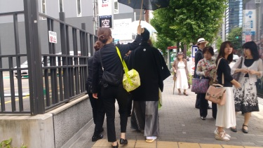 While walking down the street I saw someone walking with people holding umbrellas for him. Who is this important man?