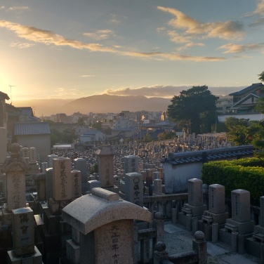 Buddhist cemetary with a pretty amazing sunset.