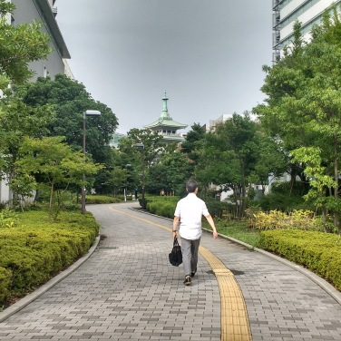 Man walking along a path.