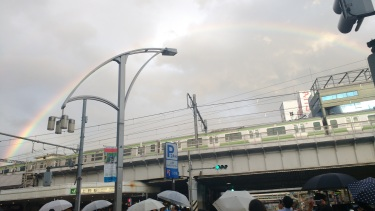 A rainbow over a train. Otherwise known as a trainbow.