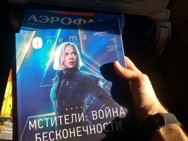 Which member of the Avengers is on the cover of the in flight magazine? Natasha Romanov, naturally.